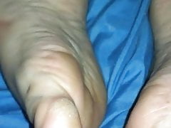 At her feet and pussy play