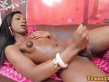Black bikini tgirl jerking her dick on couch