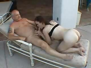 A women sucking old men's cock