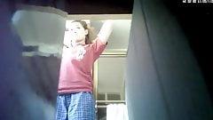 Candid camera: girl shaving in bathroom