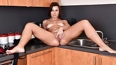 British milf Jamie Ray playing with herself in the kitchen
