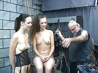 Cute young bdsm girls are made to shock each other in the dungeon