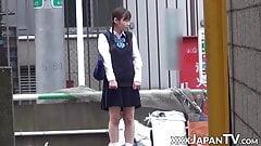 Japanese teen toys pussy over panties during school break