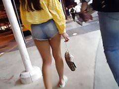 Candid voyeur teen showing off cheeks in short shorts