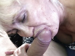 Mature sucks cock