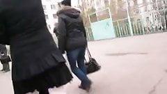 Girl in white seamed fishnet stockings going upstairs