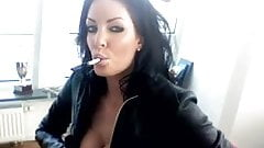 Smoking brunette - leather jacket