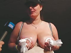Danish woman (39) milks her huge boobs at a sex convention