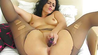 Spanish milf Montse Swinger fucks nyloned cunt with dildo