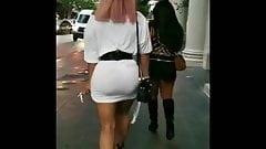 Big ass in very short white dress walk