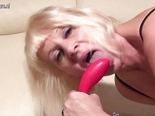 Old but hot granny gets a phone call and masturbate