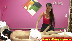 Busty asian masseuse tugs client on spycam