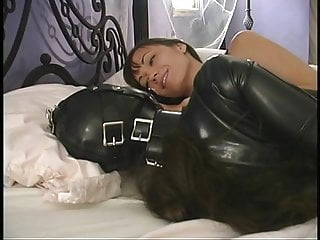 Sexy mistress has her hot slave in a rubber suit