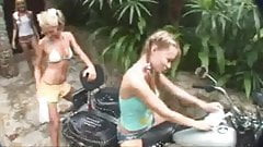 REAL teen rubbing down a motor bike