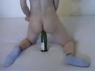 With bottle of wine