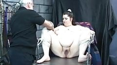 Dungeon master loves to tease this fat girl's shaved pussy with vibrator