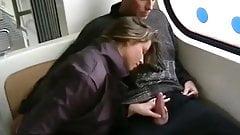 She sucks his cock inside a train