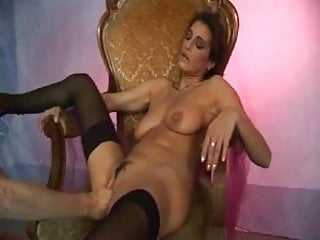 Brunette MILF with hard nipples fisted