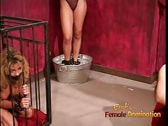 Kinky dominatrix enjoy spanking and whipping a sexy brunette