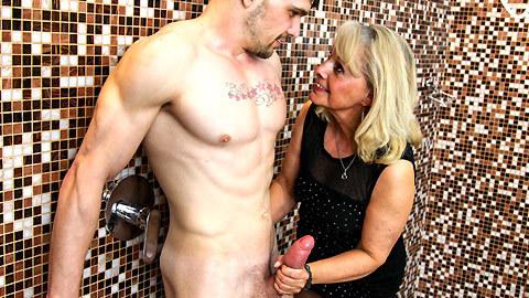 Grandma jerks young cock