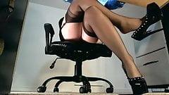 Underdesk tease showing stockings over nylons