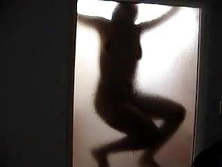 Hot woman in shower filmed from outside