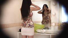 Peeping inside the skirt of a slender japanese girl