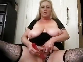 Blonde Mature Chubby plays with vibe in chair