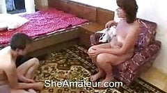 Horny mother wakes up her young boy