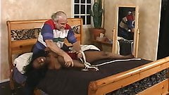 Masturbating black beauty gets captured and bounded by ponytailed dude