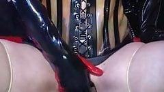 A blatex blonde slave fingering her queen