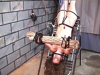 Hot brunette on bondage table takes pain