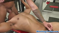 Muscular stud tugging cock in the gym