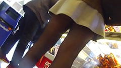 Candid tight legs with skirt and boots