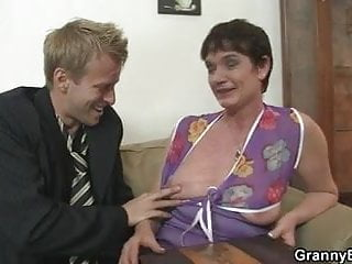 Old bitch in black stocking rides his horny cock