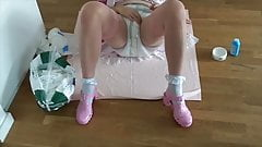 Sissy Maid changes her diapers ...