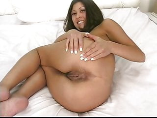 Asian slut shows off her tight asshole on a couch