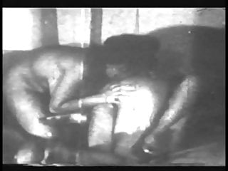 Grainy black and white footage of woman with nice boobs fucking and sucking