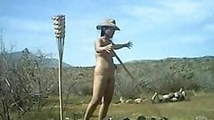 Nude female farm worker outdoo