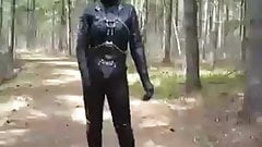 Full leather enclosure wank in public in the woods.