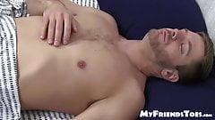Hunky Sean Holmes masturbates while his buddy sucks his toes
