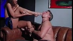 Brunette foot fucks older stud's cock