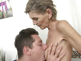 Naughty granny fucking her toy boy on the couch