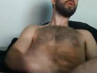 Very handsome bearded guy stroking with his cum