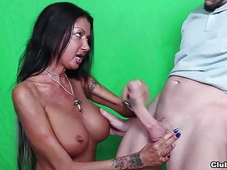 Busty milf jerks off a big dick