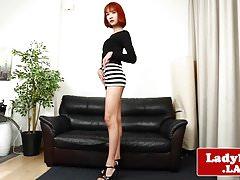 Redhead ladyboy pulling her big cock solo
