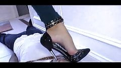 Beautiful woman with 7 inch metal high heels