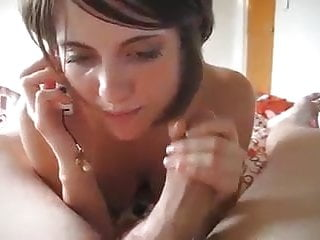 Brunette girl sucks cock while she is on the phone