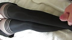 Thick cum on her nylon legs, tights layered over stockings