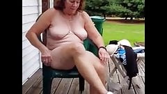 Nancy 70 strips for you outdoors as cars drive